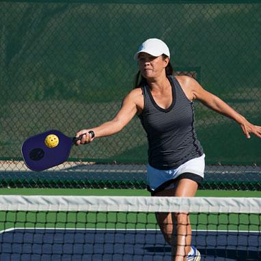 woman in grey tanktop playing pickleball
